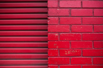 Red brick wall and red garage door