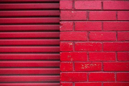 Red brick wall and red garage door
