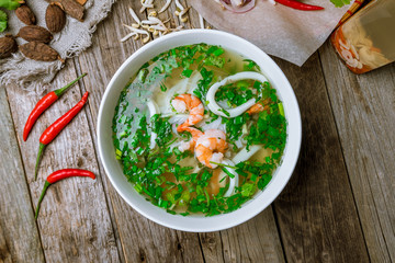Vietnamese soup Pho with shrimp and squid