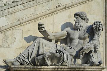 Palazzo Senatorio, in Piazza del Campidoglio de Roma or Capitoline square, Rome, Lazio, Italy - July 2, 2015: statue of Nile River god, part of an ensemble formed of two ancient statues of river gods