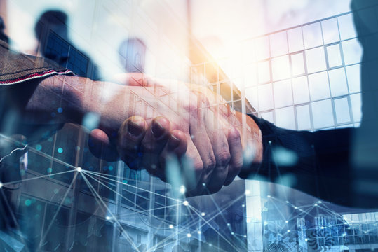 Handshaking business person in the office with network effect. concept of teamwork and partnership. double exposure