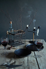 Couple of glasses of wine on a rustic wooden table scape.