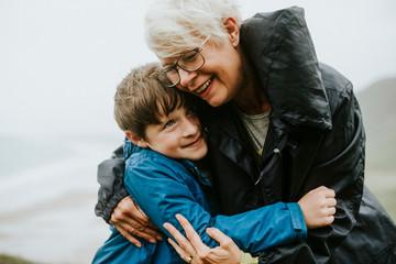 Happy grandmother hugging her grandson