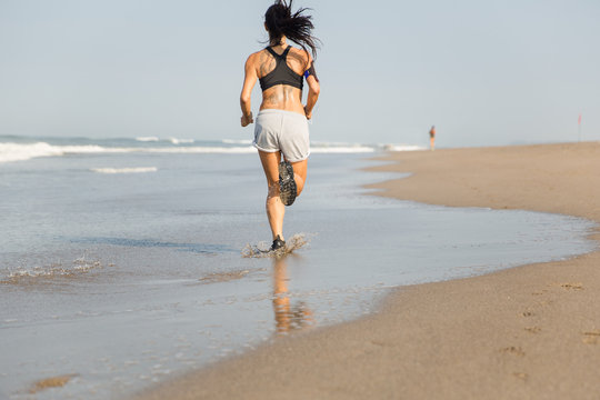 Woman on a morning beach run