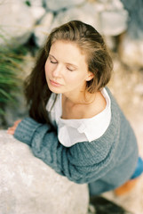 young woman with closed eyes