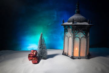 New Year's still-life postcard red lamp candle wax-boxes gift-box Christmas tree light bulbs lights wooden background snow