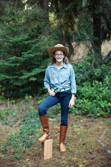 Preteen girl poses in her costume for cowboy day of spirit week at her middle school.