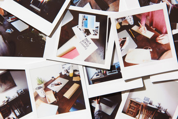 Arrange of polaroids with home workspace