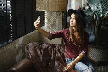 Young woman shooting with smartphone