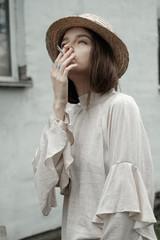 beautiful smoking girl in a hat