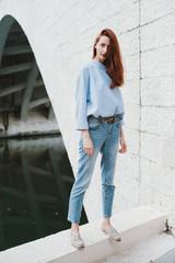 Stylish woman posing outdoors
