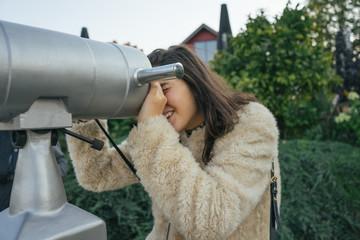 Girl Looking Through a Binoculars.
