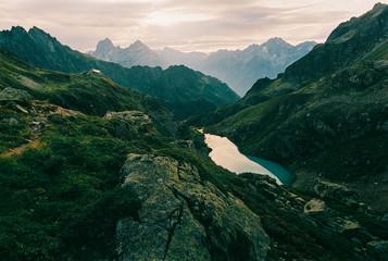 Magnificent Alpine Sunrise Over Turquoise Mountain Lake Shot on