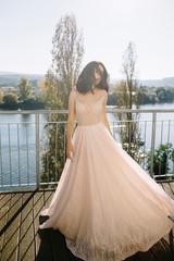 Young woman on a terrace wearing long dress