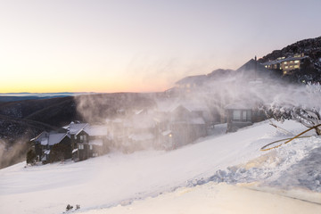 snow blower creating a cloud of mist in the morning at a ski res