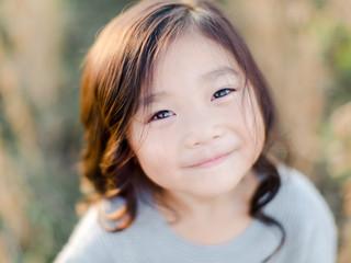 Little girl standing in a soy bean field