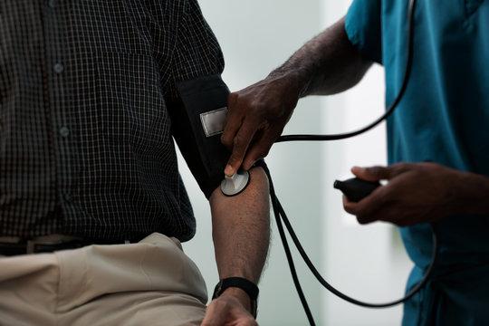Exam: Doctor Checks Blood Pressure Of Senior Male