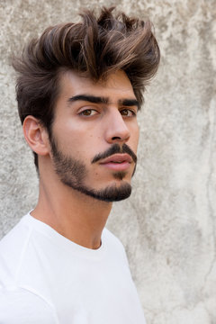 Portrait of a handsome young man with goatee looking at camera