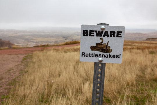 Rattlesnake Caution Sign in the Badlands of South Dakota, USA