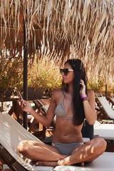 Attractive female posing near pool