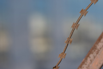 Blurred background with rusty metal wire