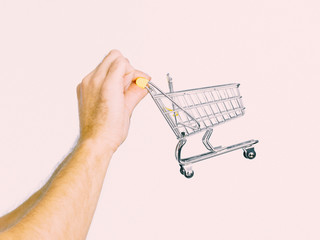 Male hands holding empty shopping cart
