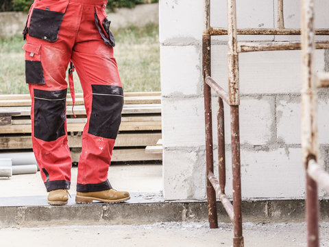 Person wearing red worker trousers