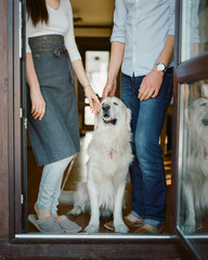 Crop couple with dog at home