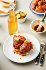 Delicious fried chicken toast with pickles and beer.