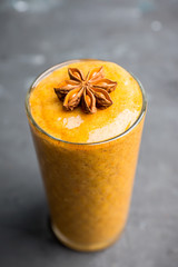 Fresh persimmon smoothie with banana and spices. Selective focus. Shallow depth of field.