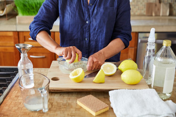 Mature woman making her own natural cleaning products at home
