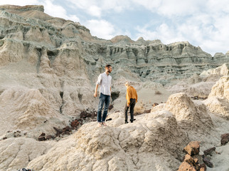 Lifestyle image of young adult friend couple male female together in high desert blue basin area northwest USA