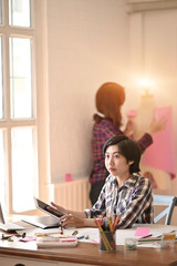 Team fashion designer working tablet and compnter on workplace with design new fashion.