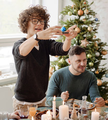 Woman capturing festive table