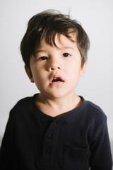 Portrait of little kid looking up