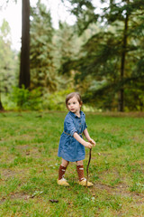 Adorable Little Girl Hiking in Forest