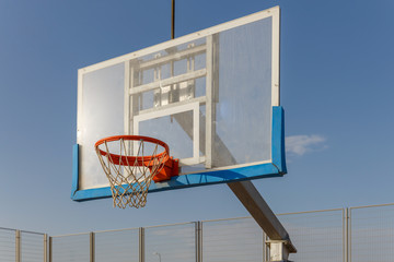 Close up of basketball board under  under the sky at morning
