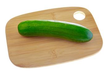 Big green cucumber on cutting board