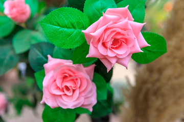 Two synthetic roses