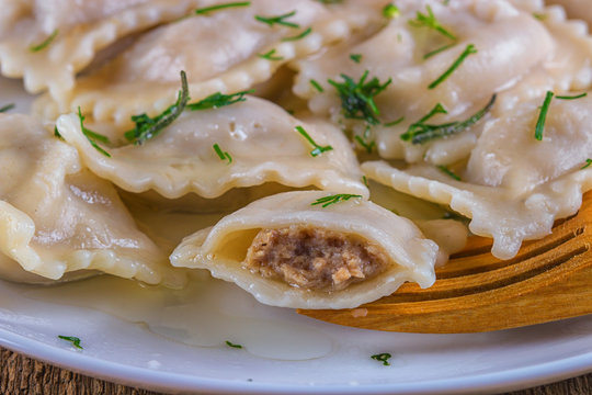 Italian ravioli stuffed with meat macro on a white plate. horizontal, rustic style. Closeup