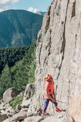 Portrait of woman belaying a rock climber