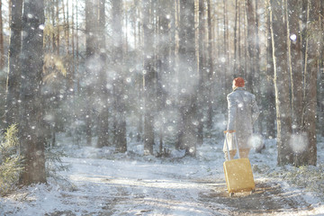 tourist in the winter forest / the guy travels against the backdrop of a winter landscape with forest, snow and trees