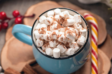 Printed roller blinds Chocolate Mug of hot chocolate with marshmallow on top and Lollipop stick on wooden background. Cozy warm winter composition