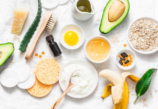 Winter skin care. Homemade natural ingredients for a nourishing face mask on a light background, top view. Flat lay