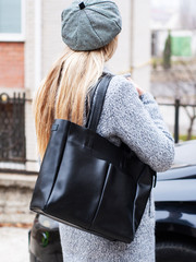 Girl with a black leather bag