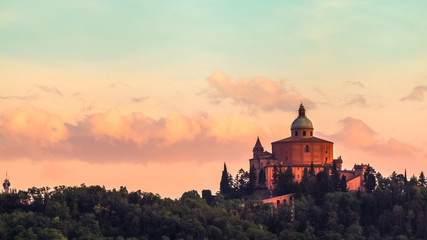 San Luca basilica church on Bologna hill, in a colorful twilight. orange and blue. in Italy