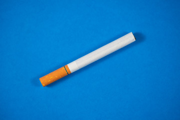 Tobacco Cigarette close up with blue background