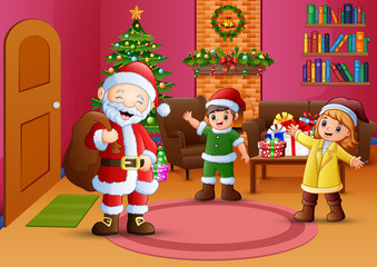 Happy santa and two kids in the living room with christmas tree
