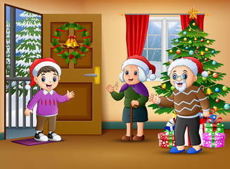 Happy family in the living room with christmas tree