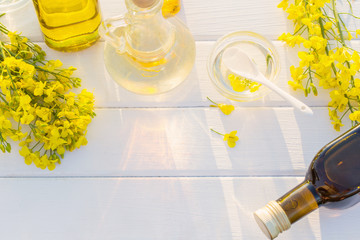 rapeseed oil on white wooden table